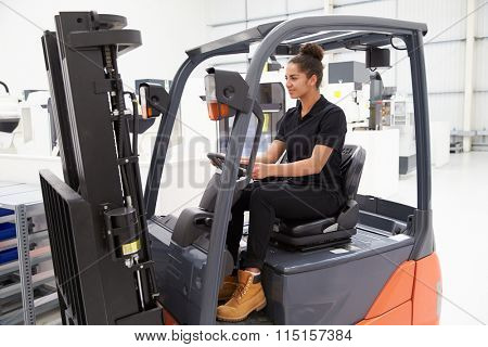 Female Fork Lift Truck Driver Working In Factory