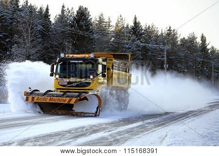 Volvo FM Truck with Snowplow Clearing Road