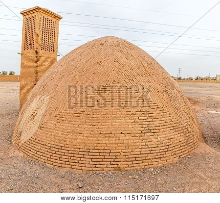 Old Zoroastrian building at the foot of the Tower of Silence in Yazd, Iran. poster