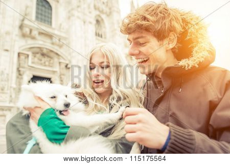 Young Couple With Dog Walking In Milan City Center