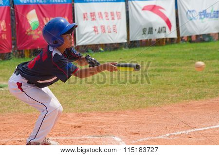 Zhongshan Panda Cup, Zhongshan, Guangdong - August 4:unknown Batter Hitting The Ball During A Match