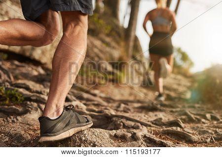 Athletes Run Through Rocky Terrain
