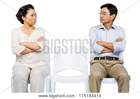 Older asian couple having an argument on white background