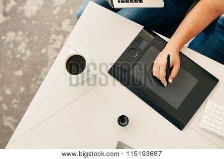 Man Using A Stylus And Graphics Tablet.