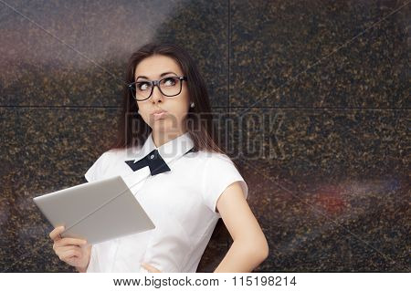 Stressed Woman Wearing Glasses Holding PC Tablet