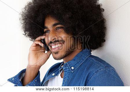 Happy Black Guy Using Mobile Pone