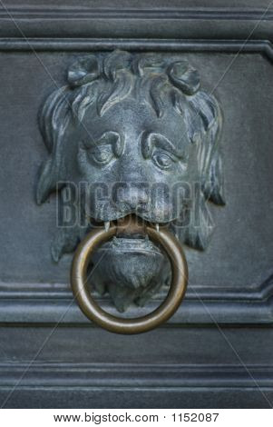 image of an old antique metal door knocker with the head of a lion poster