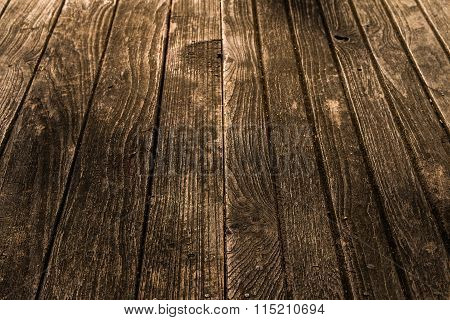 Closeup Of The Old And Weathered Brown Wood Plate