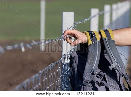 Migrant With Backpack On The Border