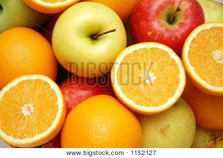 Apple And Oranges At The Market Stand