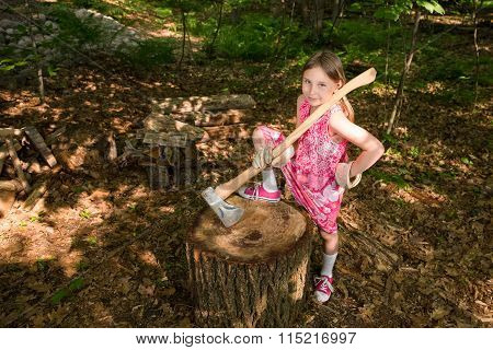 Young Girl With Ax At Chopping Block