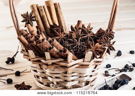 Anisetree And Cinnamon In A Wicker Basket