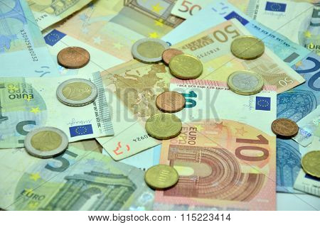 Photo bakground with euro banknotes and coins