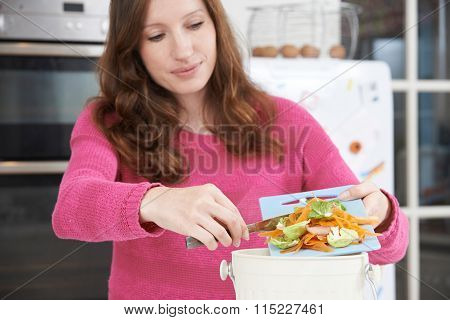 Woman Scraping Vegetable Peelings Into Recycling Bin poster