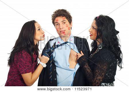 Man Kissed By Two Elegant Women