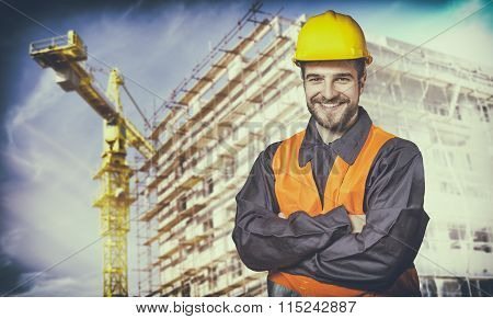 Smiling Worker With Protective Uniform In Front Of Construction Scaffolding And Construction Crane