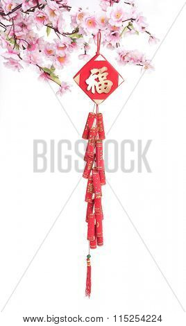 Red fire crackers over a Chinese new year background,calligraphy fu mean good bless