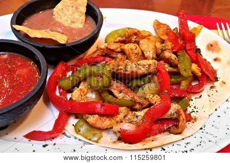 Chicken and bell pepper fajitas