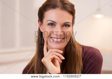 Close up face of beautiful young woman in casual clothes. Confident and smiling businesswoman looking at camera. Portrait of a smiling woman posing for camera.