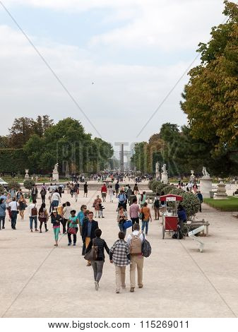 PARIS, FRANCE - SEPTEMBER 11, 2014: Paris - Local and Tourist in famous Tuileries garden. Tuileries Garden (Jardin des Tuileries) is a public garden located between the Louvre and the Place de la Concorde. France.