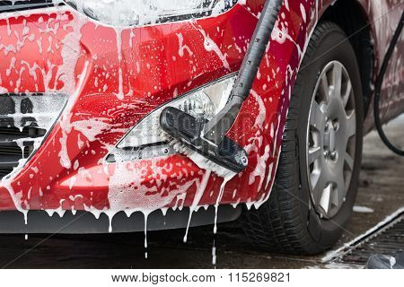 Car Being Washed By Scrubbing Brush