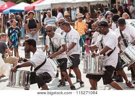 Members Of Adult Drum Group Perform At Atlanta Festival