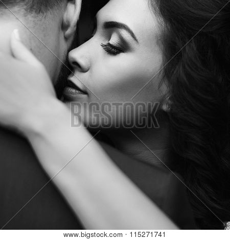 Closeup Of A Beautiful, Happy Bride Hugging Handsome Groom With Her Eyes Closed B&w