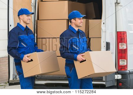 Delivery Men Carrying Cardboard Boxes