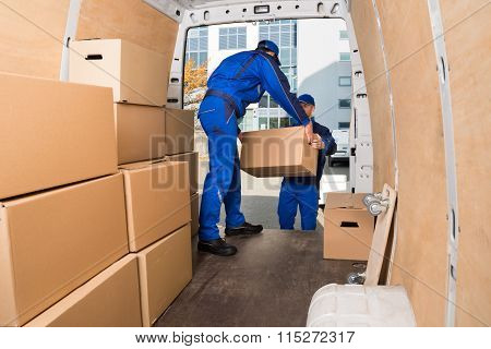 Delivery Men Loading Cardboard Boxes