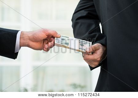 Businessman Taking Bribe From Partner