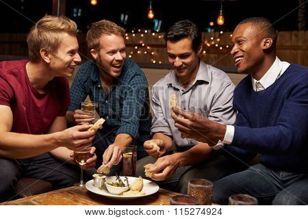 poster of Group Of Male Friends Enjoying Night Out At Rooftop Bar