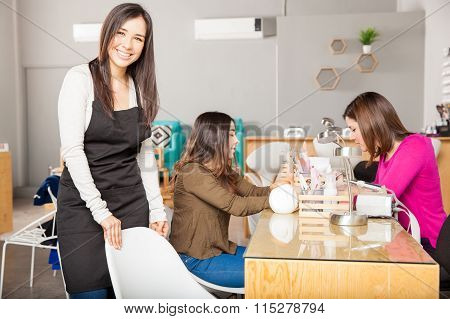 Business Owner Greeting Her Customers