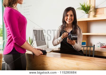 Cash Register Worker Swiping A Card