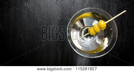 Martini With Olives On A Black Table. Free Space For Text.