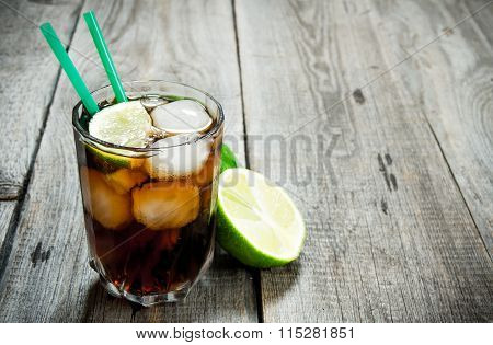 Fresh Cocktail With Lime And Mint On Wooden Table. Free Space For Text.