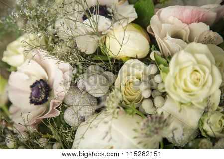 Close-up of a flower arrangement with white anemones, roses and peonies