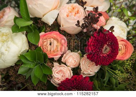 Close-up of a beautiful flower arrangement with peonies, roses and other flowers