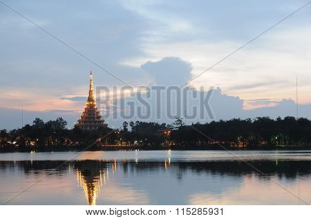 Temple and city reflection on a lake