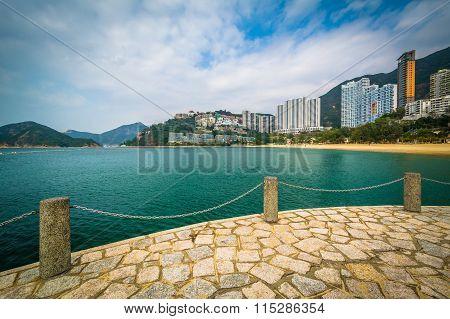 View Of Skyscrapers And Beach From A Pier At Repulse Bay, In Hong Kong, Hong Kong.
