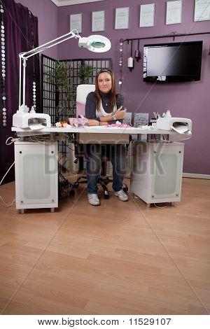 Beautician in nail studio