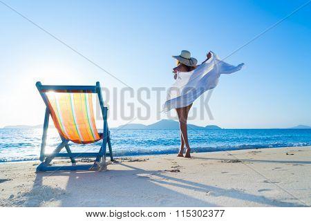 Woman enjoying the sun at the tropical beach
