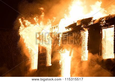 Huge Flame Distracting House on Fire. Fire Safety Concept