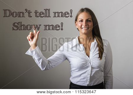 Don't Tell Me! Show Me! - Beautiful Girl Touching Text On Transparent Surface