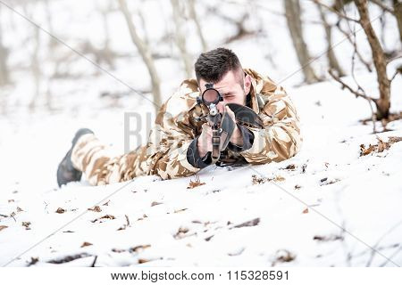 Young Sniper Aiming Through Scope And Shooting With Rifle During Operation - War Concept Or Hunting