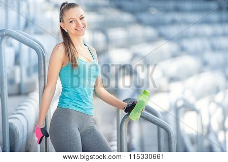 Fitness Concept - Sexy Woman Drinking Water During Workout And Training. Cross Fit Workout On Stairs