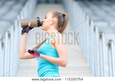 Portrait Of Healthy Fitness Girl Drinking Protein Shake. Woman Drinking Sports Nutrition Beverage Wh