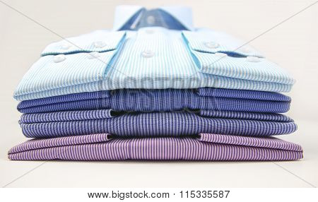 Mens t-shirt folded on background