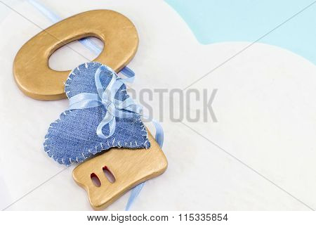 Denim Heart Wrapped Around A Big Wooden Key