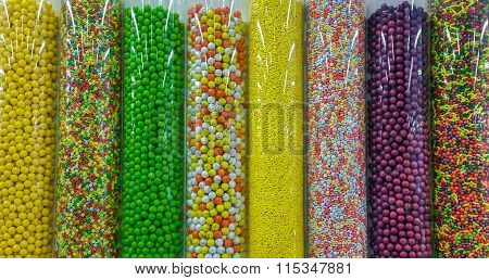 Thousands Of Colorful Candies In Transparent Plastic Tubes