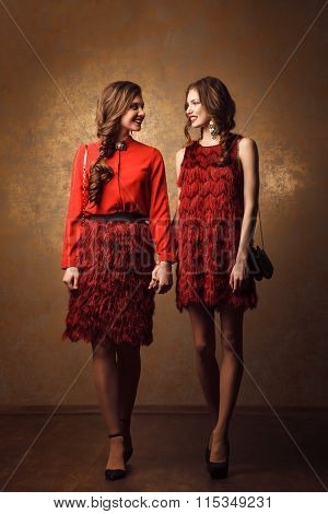 Two Beautiful Cheerful Women Walking In Red Dress